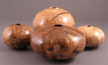 Four Burl Vessels